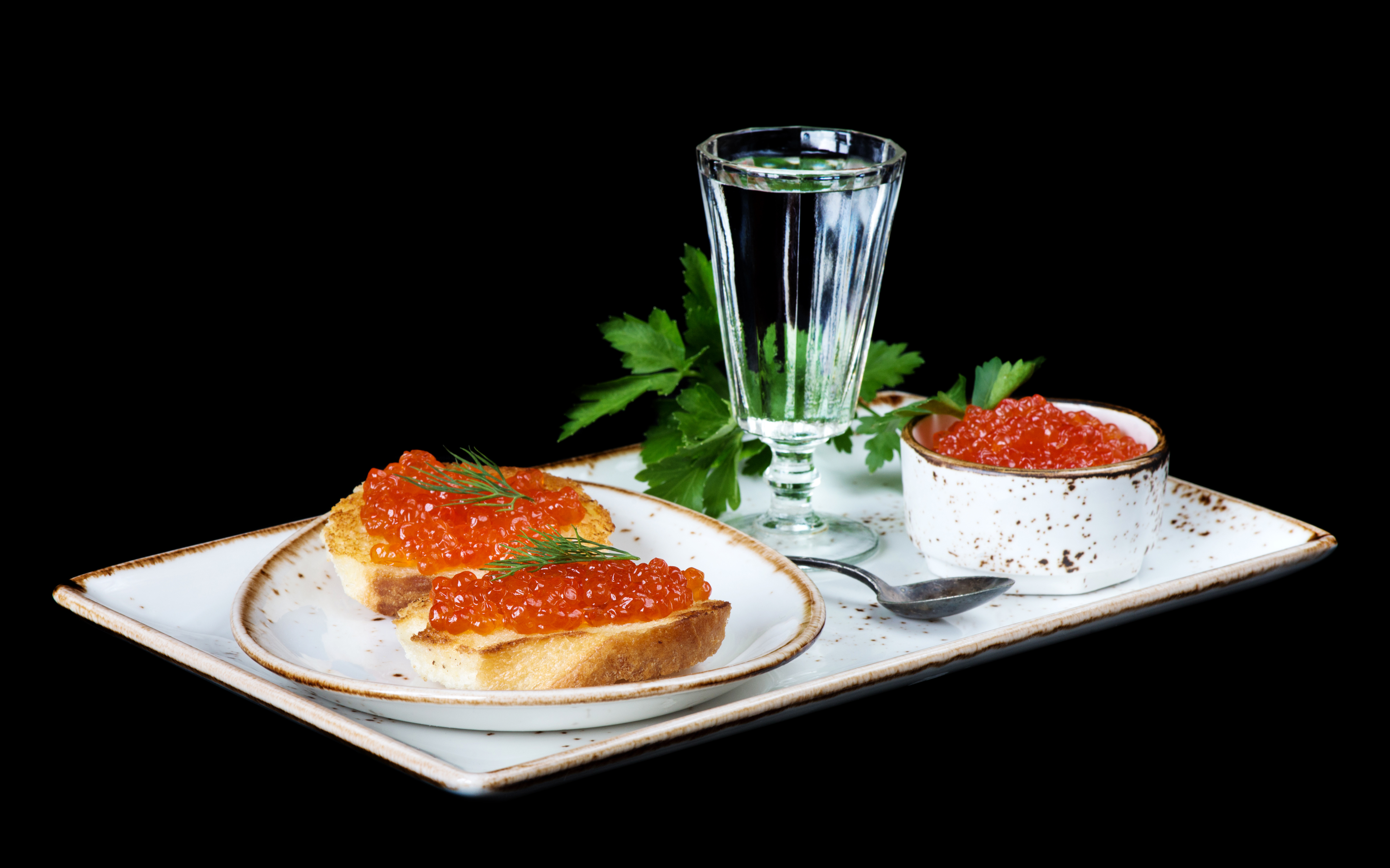 2017Food_A_glass_of_vodka__sandwiches_with_red_caviar_and_parsley_on_the_table_118419_.jpg