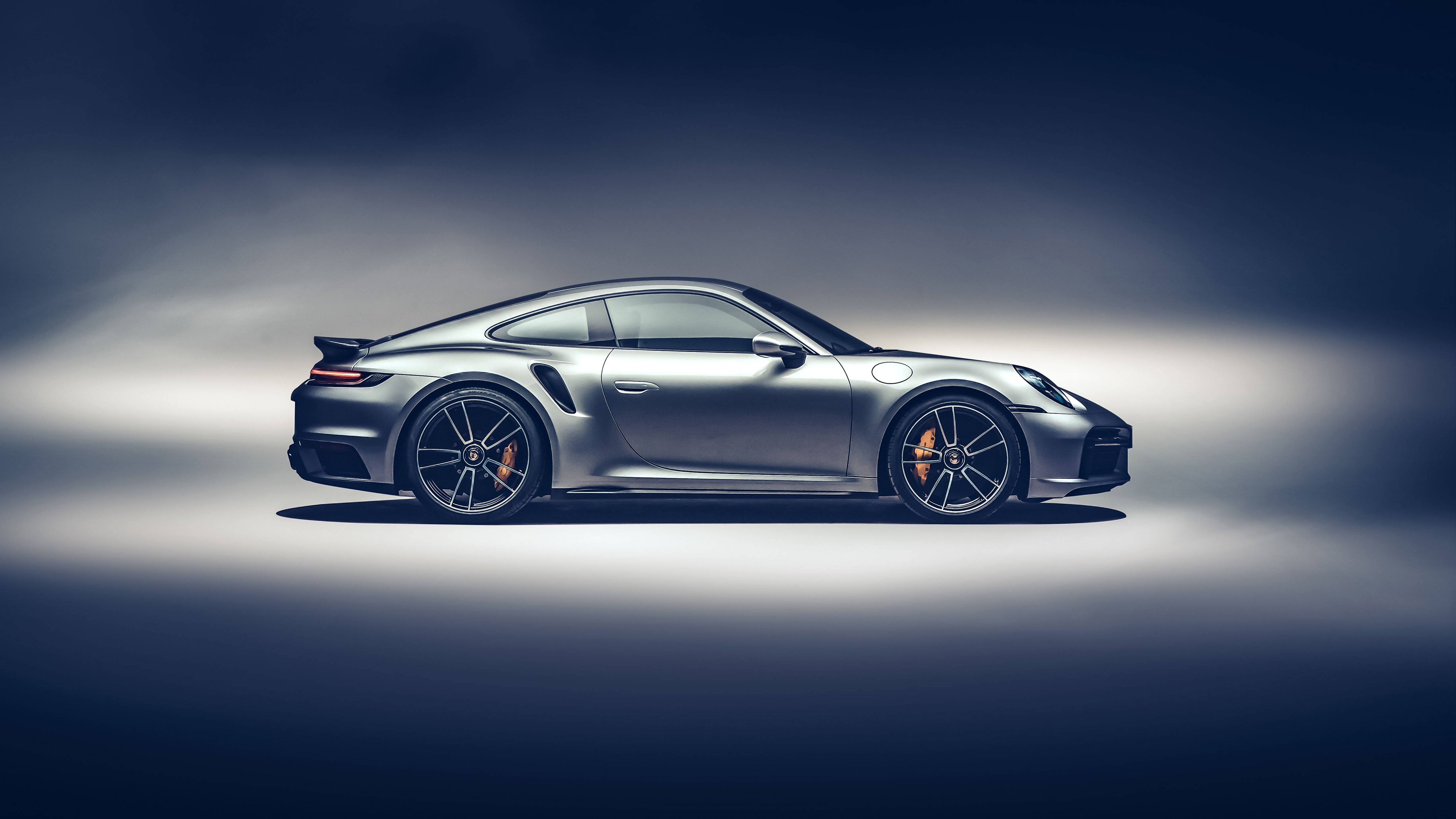 Wallpaper Silver Porsche 911 Turbo S 2020 car side view on gray background
