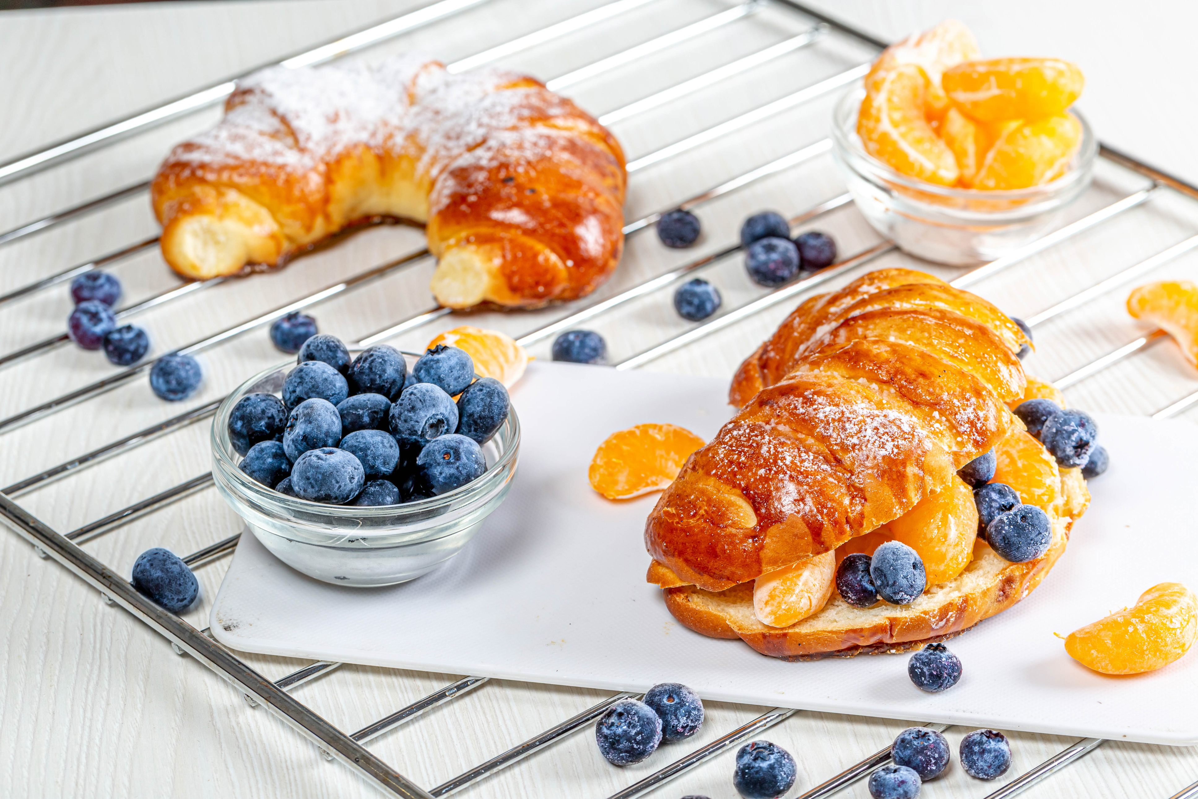 Wallpaper Fresh croissants with blueberries and mandarin slices