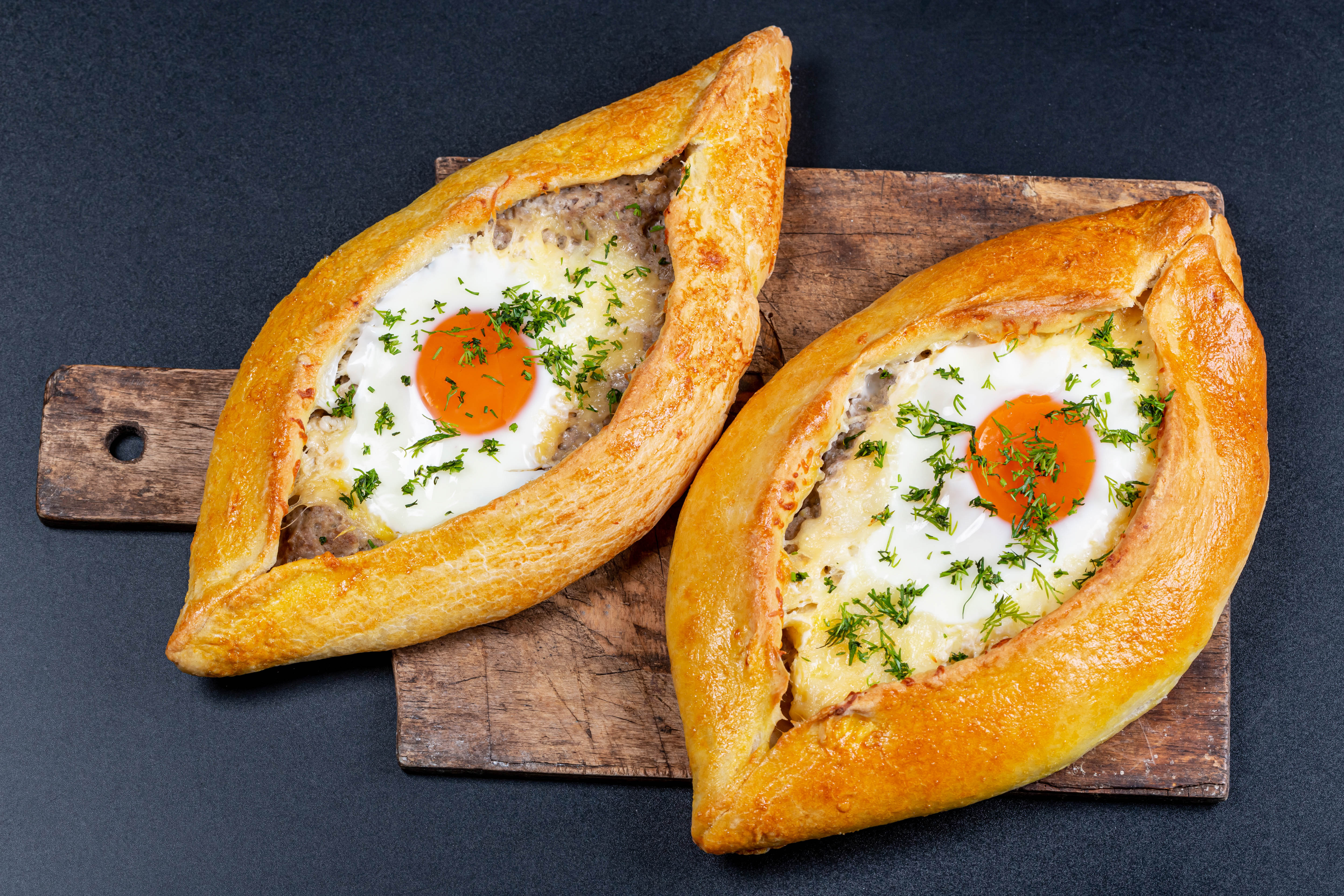 Wallpaper Two large fresh khachapuri with egg on the board