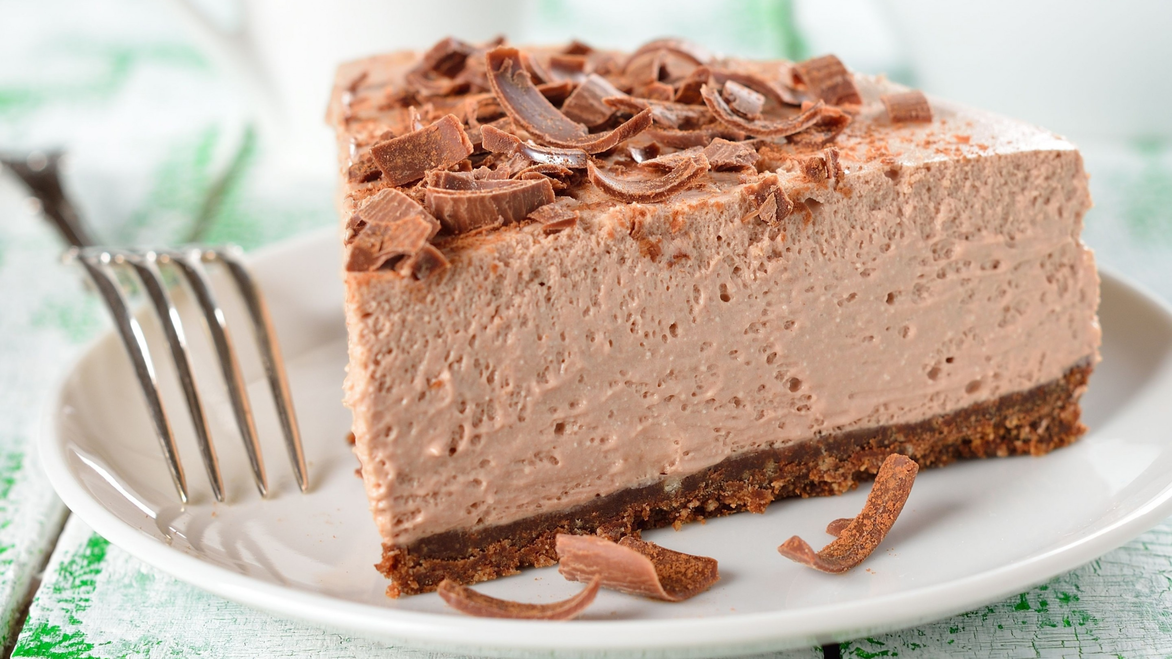 Wallpaper Mousse cake with chocolate chips on a plate