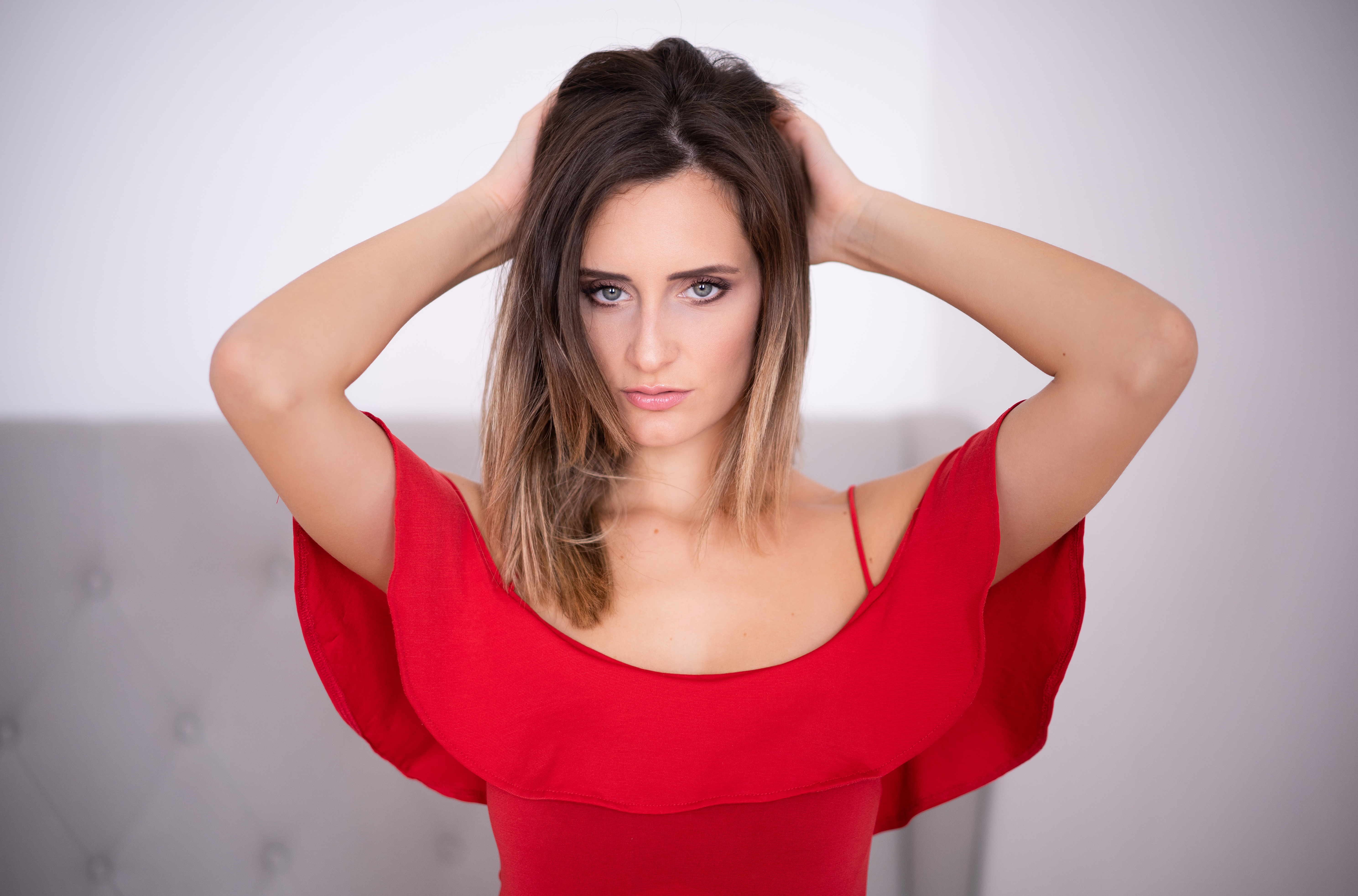 Wallpaper Beautiful girl in a red dress with hands in hair